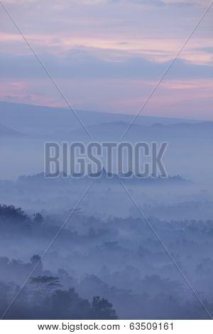 View of Borobudur Temple from Bukit Punthuk Setumbu Hill at sunrise
