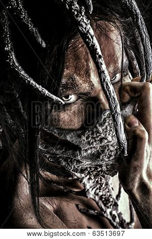 Close-up portrait of a mythical creature male. Alien creature. Horror. Halloween. Isolated over white.