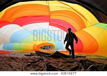 Man inflating a hot air balloon