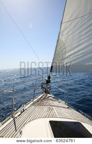 Clsoeup of boat sail and deck by sunny day