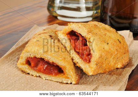 Closeup Of Pizza Pockets And Beer