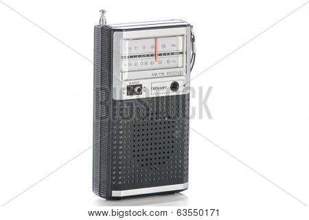 1960's era transistor radio isolated on a white background. poster