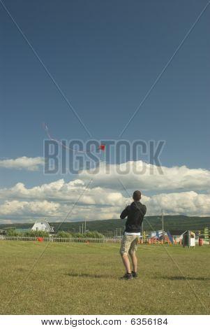 Man Driving A Kite