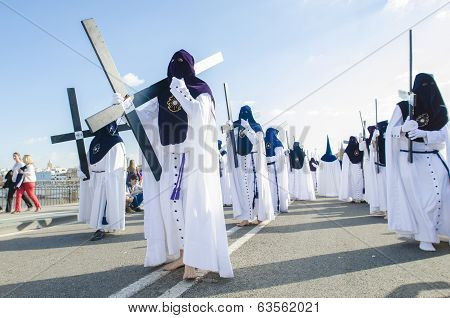 Seville. Spain - April 13: Penitents Of The Brotherhood Of