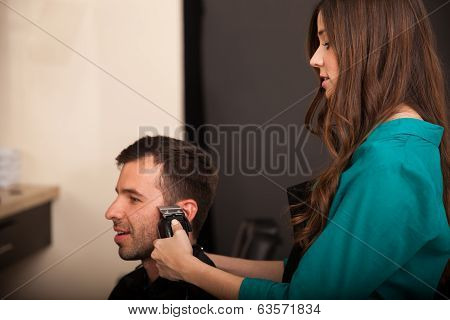 Barber Trimming Sideburns