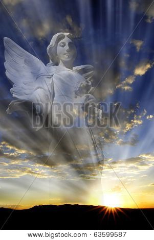 Angel with wings in front of heavenly light