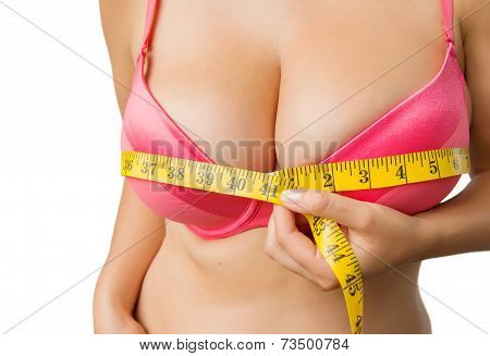 Woman with big breasts measuring her bust size with yellow measurement tape. poster