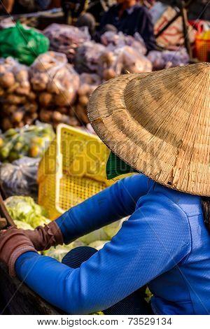 Woman Selling Vegetables On Floating Market On Boat, Mekong, Vietnam