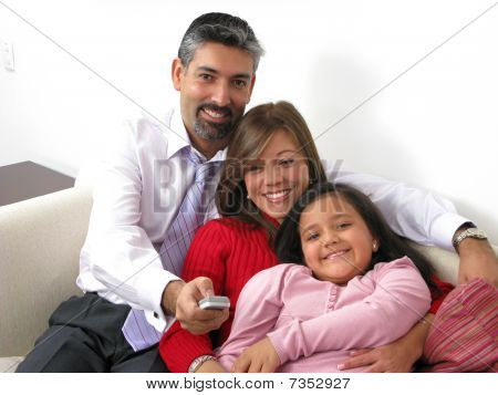 Smiling Family Watching Tv In The Living Room