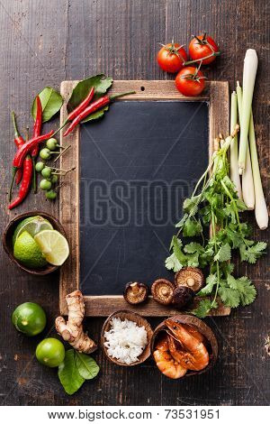 Ingredients For Spicy Thai Soup Tom Yam With Coconut Milk, Chili Pepper And Seafood On Vintage Slate