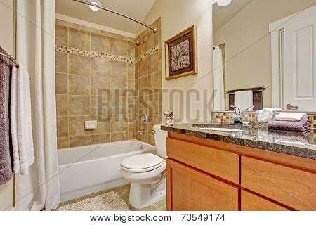 Bathroom With Tile Wall Trim