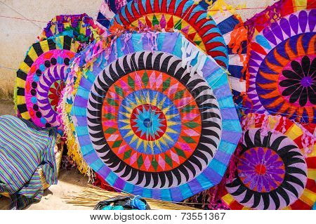 Colorful handmade kites for sale on the street. Locals display huge circular kites called barriletes & fly smaller ones each year in the cemetery on All Saints' Day to honor spirits of the dead. poster