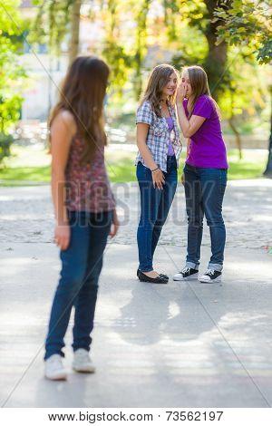 Envious Girls Talking Behind Her Girlfriend