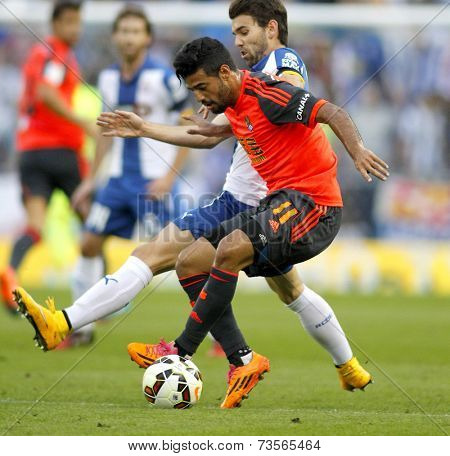 BARCELONA - OCT, 5: Carlos Vela of Real Sociedad in action during a Spanish League match against RCD Espanyol at the Estadi Cornella on October 5, 2014 in Barcelona, Spain