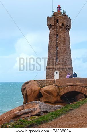 Ploumanach Lighthouse And Family Near.the Pink Granite Coast.