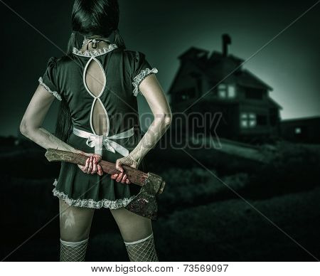 Dirty Woman Stands Back Holding A Bloody Ax