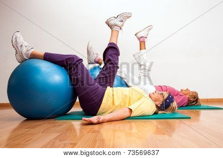 Senior Women Working Out With Fitness Balls.