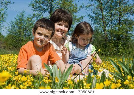 Happy Family Among Yellow Flowers
