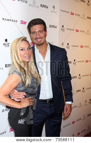 LOS ANGELES - OCT 9:  Jacob Busch, Adrienne Maloof at the Star Magazine Scene Stealers Event at Lure on October 9, 2014 in Los Angeles, CA