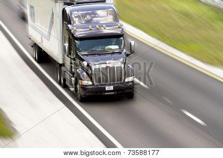 Tractor Trailer Rolling Down Highway