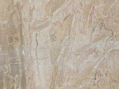 large slab of variegated striped beige marble with smooth smooth polished surface poster