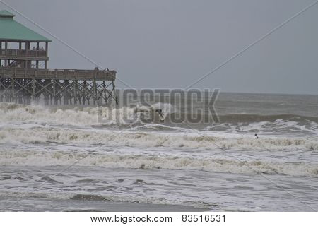 Surfing By Folly Beach Pier