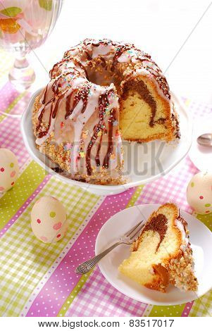 Ring Cake With Icing And Chocolate Glaze On Easter Table