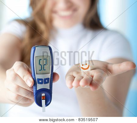 Female Diabetic Doing A Glucose Level Finger Blood Test