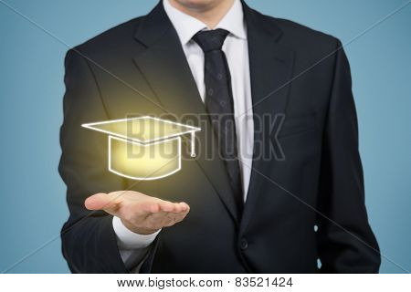Businessman Holding Gold Bachelor Ha