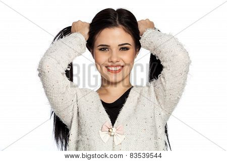 Smiling Brunette Young Woman Holding Two Ponytails