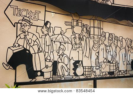 Malaysia, Penang, Georgetown - Circa Jul 2014: Cartoon Style Image Of Caricatures Standing In Line.