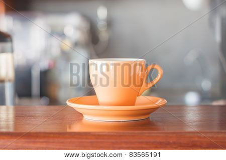 Orange Coffee Cup In Coffee Shop