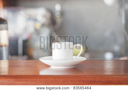Mini White Coffee Cup In Coffee Shop