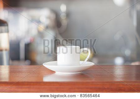 Mini White Coffee Cup In Coffee Shop