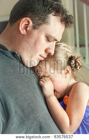 sad father comforting his crying preschool age daughter. Great parenting image poster