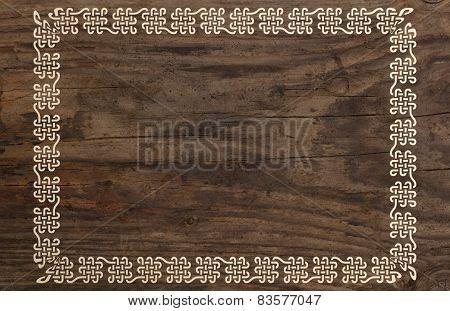 celtic border knotwork ornament design wooden background