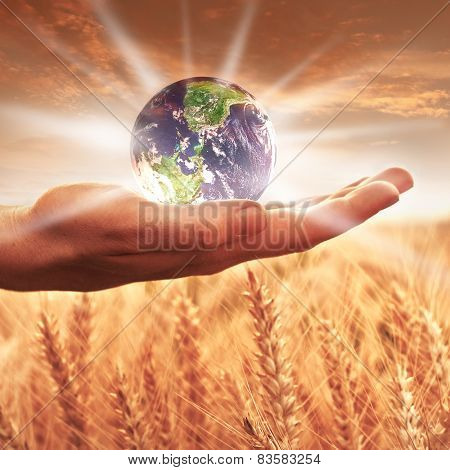 Woman holding the earth globe