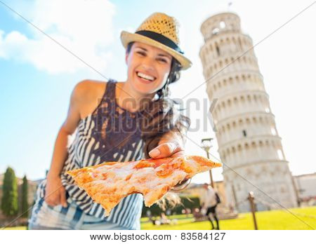 Smiling Young Woman Giving Pizza In Front Of Leaning Tower Of Pisa, Tuscany, Italy