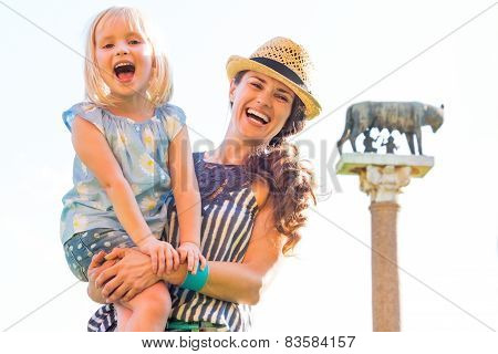 Portrait Of Happy Mother And Baby Girl In Front Of Capitoline Wo