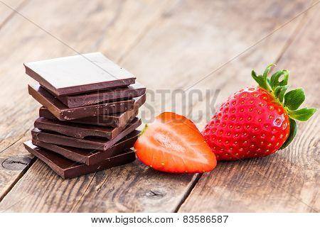 Ripe Strawberries And Dark Chocolate, Spices.