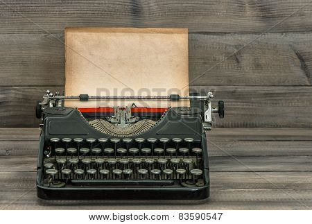 Antique Typewriter With Grungy Textured Paper Page. Vintage Style Still Life