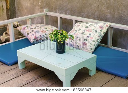 Flowers On Table In Coffee Shop