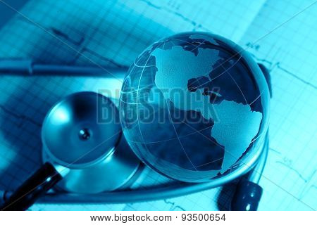 Glass Globe And Stethoscope On A Background Ecg