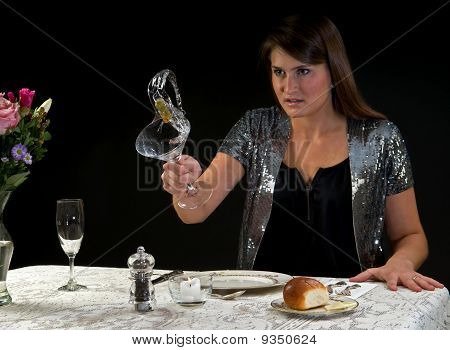 young woman throwing drink
