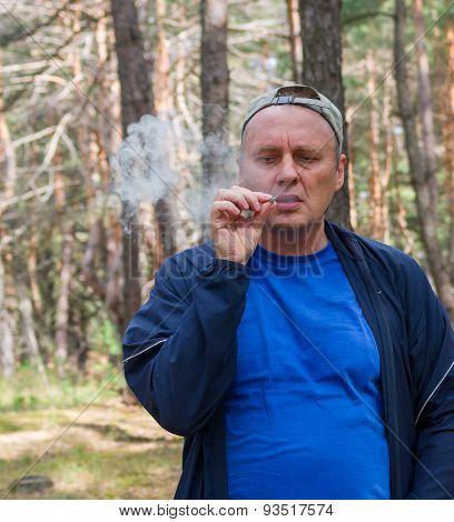 Mature man tasting new home-grown tobacco