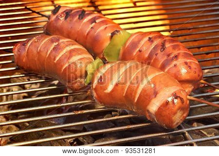 Fatty Sausages On The Hot Barbecue Flaming Charcoal Grill
