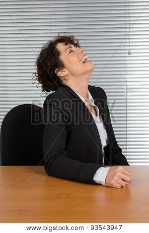A Very Happy And Cheerful Lady Brunette Is Giggling