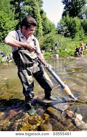 A Competitor Uses A Hand Pump To Vacuum Alluvial Gold