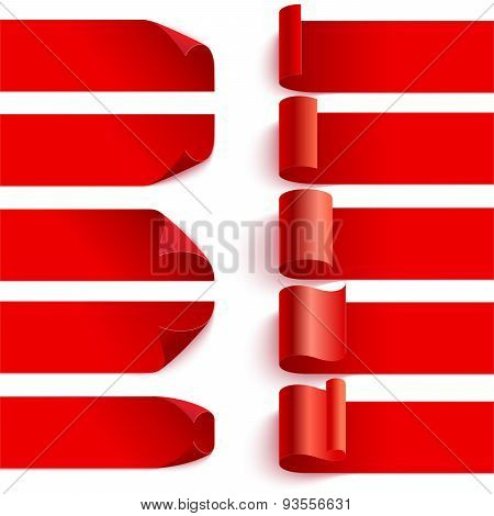 Set of curled red ribbons with shadows on white backgroun