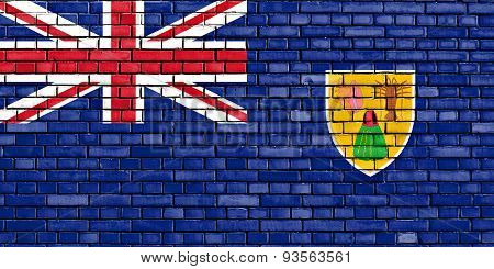 flag of Turks and Caicos Islands painted on brick wall poster